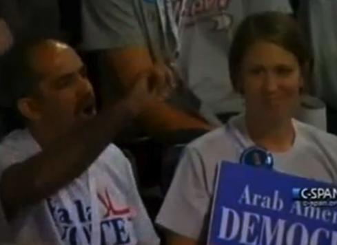 Delegates Protest Deny God
